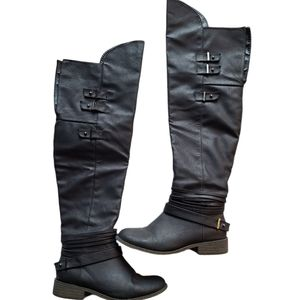 JustFab over the knee black zip up boot.